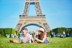 Couple having picnic near the Eiffel tower in Paris, France Stock Images