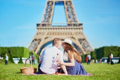 Couple having picnic near the Eiffel tower in Paris, France stock image