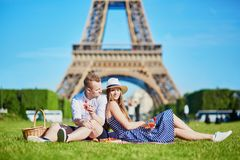 Couple having picnic near the Eiffel tower in Paris, France stock photo