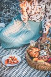 Couple having picnic at seaside with sparklng wine and snacks. Summer beach picnic at sunset. Young couple having weekend picnic outdoors at seaside with fresh royalty free stock photos