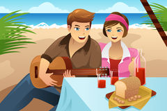 Couple having a picnic Royalty Free Stock Photos