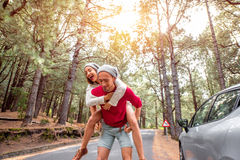 Couple having piggyback ride in the forest Stock Photography