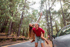 Couple having piggyback ride in the forest Royalty Free Stock Image