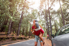 Couple having piggyback ride in the forest Stock Photos