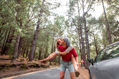 Couple having piggyback ride in the forest Stock Image