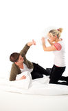 Couple having a pillow fight Royalty Free Stock Photography