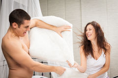 Couple Having A Pillow Fight Stock Image