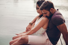 Couple having problem while sitting in nature. He is trying Stock Photos