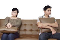 Couple having problem on the sofa Stock Image
