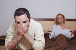 Couple having problems in the bedroom Stock Photo