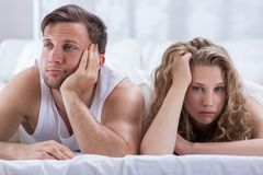 Couple having problems in bedroom Royalty Free Stock Images