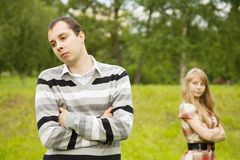Couple having quarrel. Young couple having quarrel. Focus on man only Stock Photo