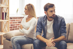 Couple having a quarrel. Beautiful couple is sitting back to back on the couch while having a quarrel Stock Photography