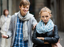 Couple having quarrel on city street. Young couple having quarrel on city street in an autumn day Stock Photos