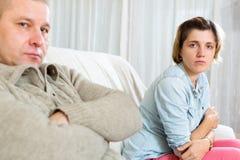 Couple having quarrel at home. Couple quarrel.Sad ordinary women against depression men at home Royalty Free Stock Image