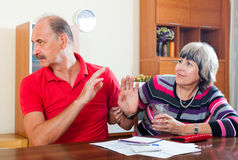 Couple having quarrel over   documents Royalty Free Stock Image