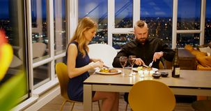 Couple having red wine and dinner 4k. Couple having red wine and dinner at home 4k stock video