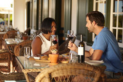 Couple having a red wine at restaurant Royalty Free Stock Photo