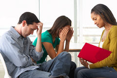 Couple Having Relationship Counselling. With Female Counsellor Stock Images
