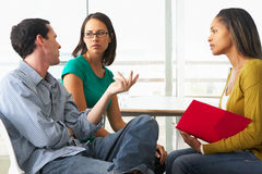 Couple Having Relationship Counselling. With Female Counsellor Royalty Free Stock Photos