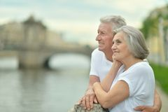 Couple having rest near river Royalty Free Stock Images