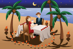 Couple having romantic candle light dinner Stock Images