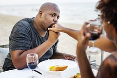 Couple having a romantic dinner at the beach royalty free stock photo