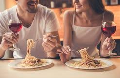 Couple having romantic dinner stock images
