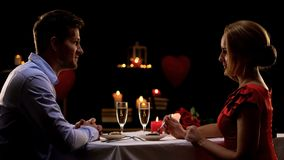 Couple having romantic dinner in high-quality restaurant, evening for two, date stock images