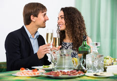 Couple having romantic dinner in home Royalty Free Stock Images
