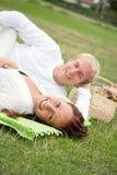 Couple having a romantic picnic. On the grass Stock Photo