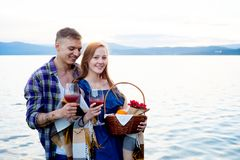 Romantic picnic by the lake. Couple is having a romantic picnic by the lake Royalty Free Stock Photo