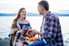 Romantic picnic by the lake. Couple is having a romantic picnic by the lake Stock Photos
