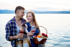 Romantic picnic by the lake. Couple is having a romantic picnic by the lake Stock Images