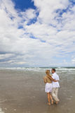 Couple Having Romantic Walk On A Beach Stock Photos