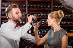 Couple having romantic wine tasting at the cellar Royalty Free Stock Images