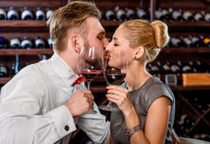 Couple having romantic wine tasting at the cellar Stock Photo