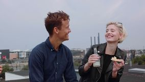 Couple having rooftop party stock video