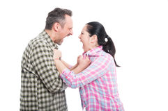 Couple having a screaming fight. And disagreements looking mad isolated on white royalty free stock photography