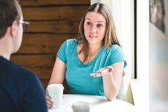 Couple having serious conversation and talk. Woman wondering or asking man. People fighting or having discussion royalty free stock photos