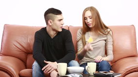 Couple having a serious discussion on the couch at home. In the living room stock video