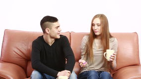 Couple having a serious discussion on the couch at home. In the living room stock footage