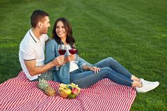 Couple having small picnic with fruits and wine stock image