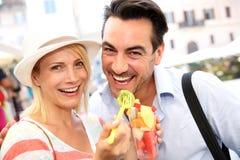 Couple having a snack Royalty Free Stock Photos