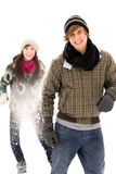 Couple having snowball fight. Young couple having snowball fight royalty free stock images