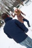 Couple having a snowball fight Royalty Free Stock Photos