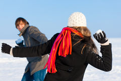 Couple having snowball fight Royalty Free Stock Photos