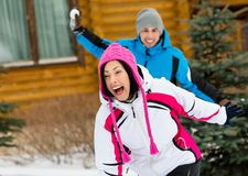 Couple having snowball fight Royalty Free Stock Images