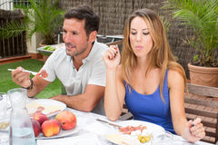Couple having some food Stock Image