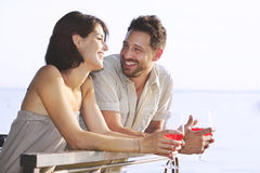Couple having a spritz time with a lake view royalty free stock images